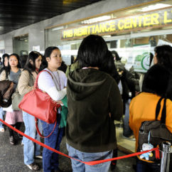 Filipino domestic helpers line up to send money at a remittance center in the central district of Hong Kong,