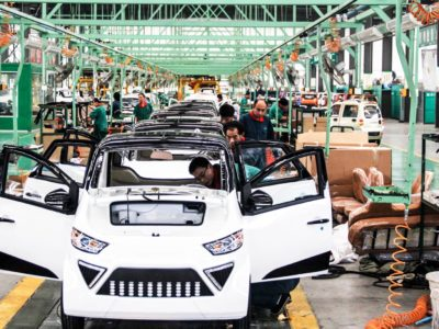Restyling the east asian economic development blueprint brink workers assemble electric cars in a factory in zouping east chinas shandong province on september 16 2014 chinas outbound investment more than doubled malvernweather Images