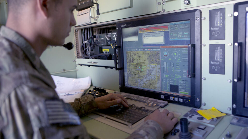 A US Army soldier monitors a US Army 14' Shadow surveillance